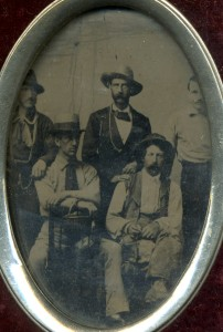 Group portrait of five men, one holding a lightship basket