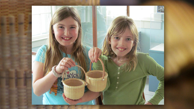 Two girls holding baskets