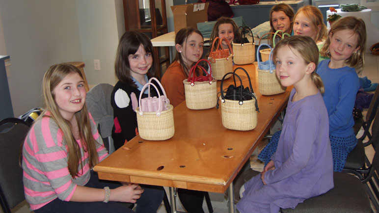 A group of girls at the table with completed baskets